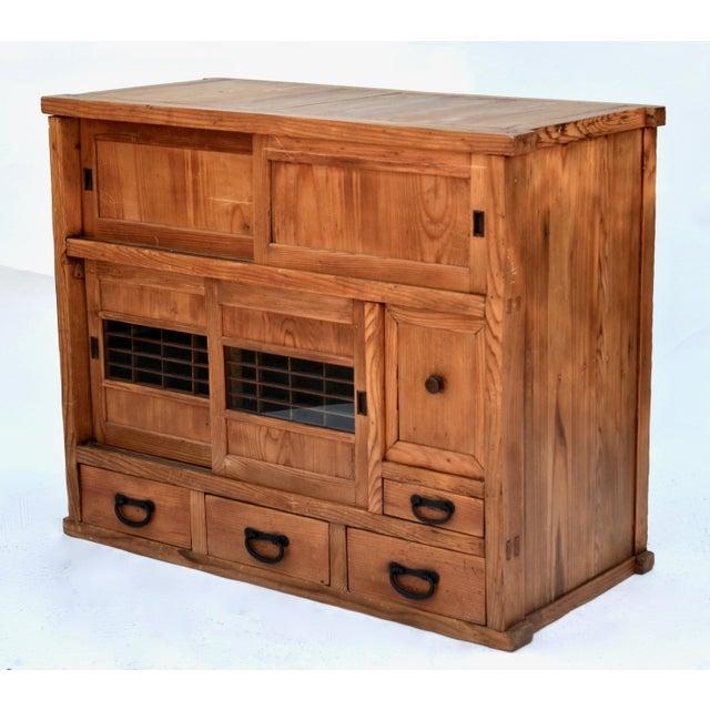 Antique Japanese small choba tansu (merchant's chest) made with Hinoki (cedar)hardwood, in original honey tone finish. Two...