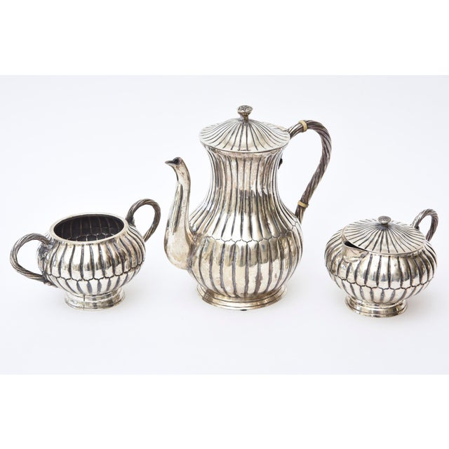 This 3 piece ribbed Mexican Sanborn hallmarked sterling silver 1940's coffee/tea service set is elegant and has great...