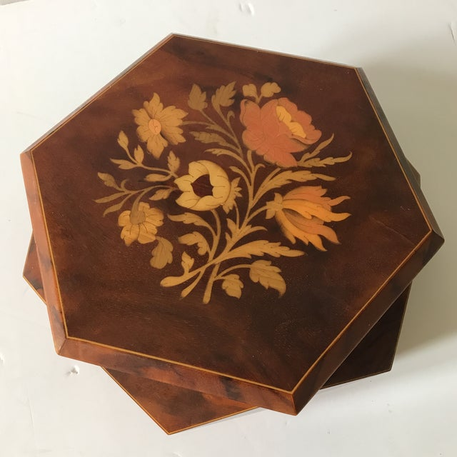 Made in Italy. Wood inlaid Flowers adorn this music box. Music function needs repair.