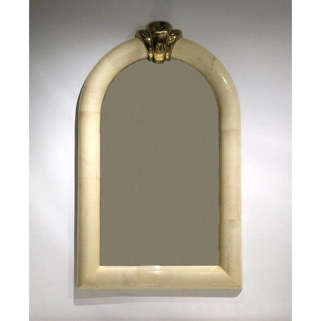 A glamorous 1980s goatskin and brass wall mirror in the manner of Karl Springer. The frame is constructed of wood covered...