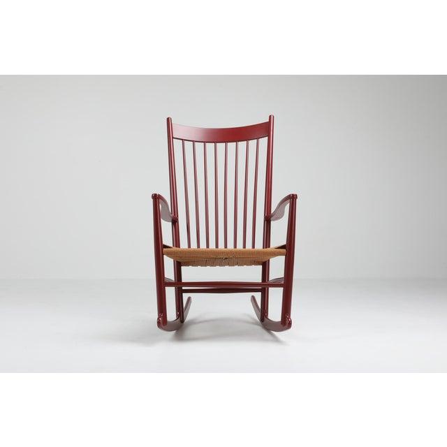 Scandinavian modern rocking chair by Hans Wegner, model J16, Fredericia Furniture, Denmark Designed in 1944, Wegner 's...