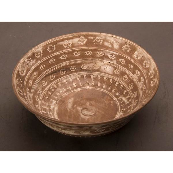 Contemporary French hand thrown and decorated earthenware bowl with a distinctive pattern. The striking pattern seen on...