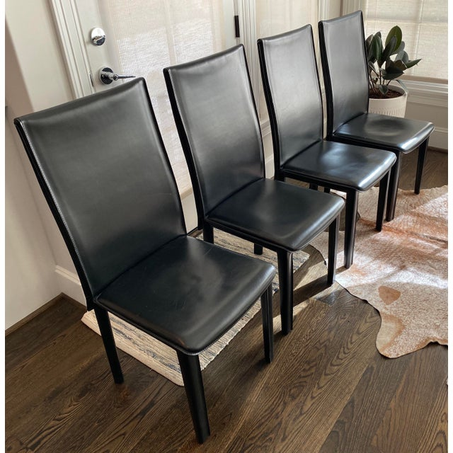 """These unique Italian leather dining chairs all feature X detail on the back. All four chairs are marked """"Arper made in..."""