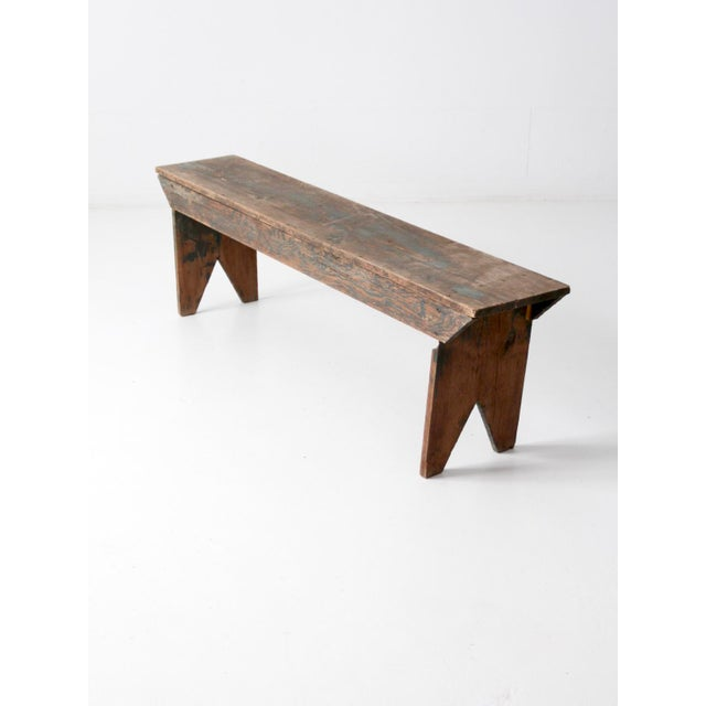 This is an antique wooden bench. The rustic farmhouse bench makes for great kitchen seating or as a place to set in the...