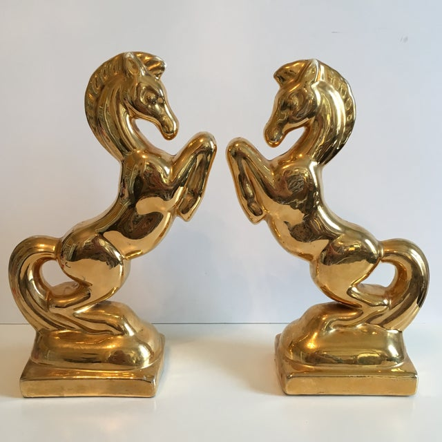 These horses are amazing! These large gold and glam porcelain horses can be used to style your bookshelf, mantel, or use...