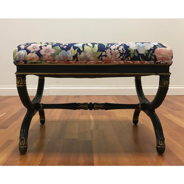 Classic beauty and style in the X form bench. Original painted finish of Black and gold over a carved wood frame without...