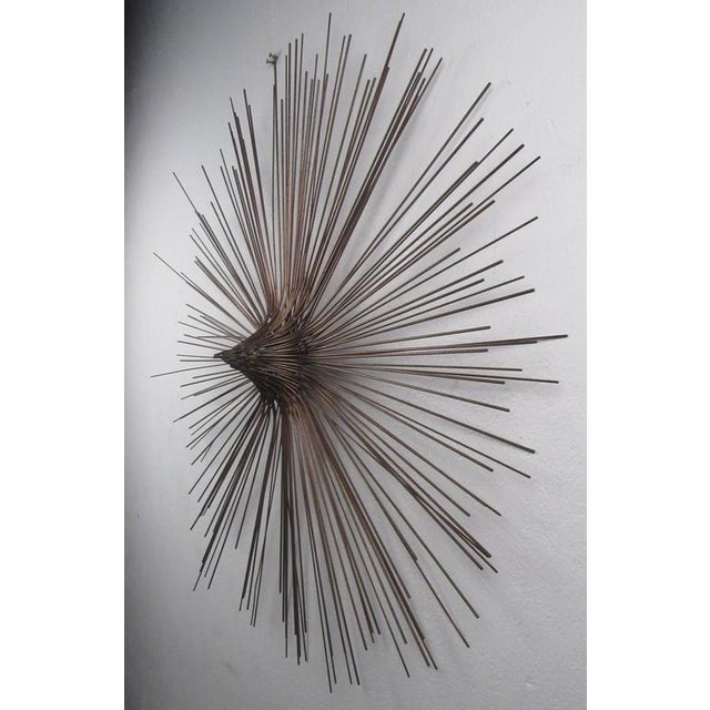 Large circular copper rod sculpture in the manner of C. Jere. Please confirm item location (NY or NJ) with dealer....