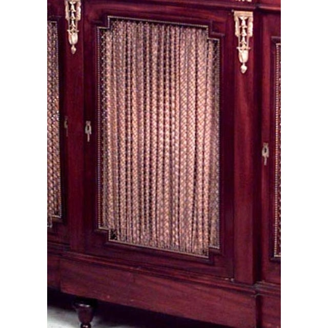French Louis XVI style (19th century) mahogany and bronze trimmed sideboard cabinet with three grill door and marble top...