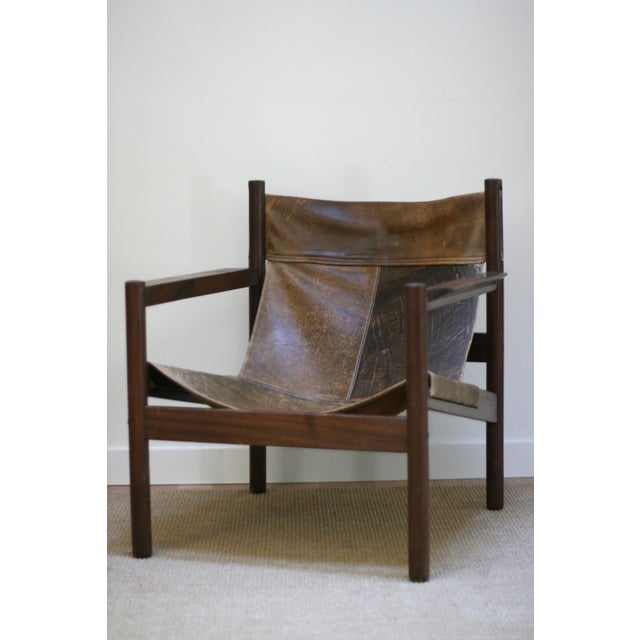 Mid-century brown leather safari, sling chair. Designed by French designer Michel Arnoult Roxinho in Brazil, circa 1960s....