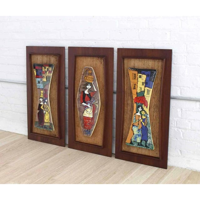 Set of very nice Mid-Century Modern art tiles wall decorations framed in walnut frames.
