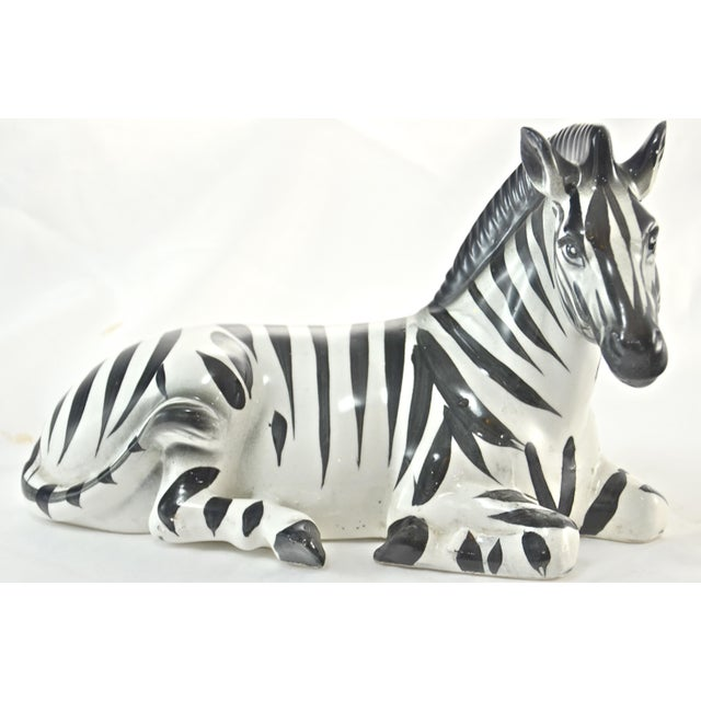 Large vintage Italian ceramic zebra hand painted in black and white. Soft under glaze smudging around muzzle and forelegs....