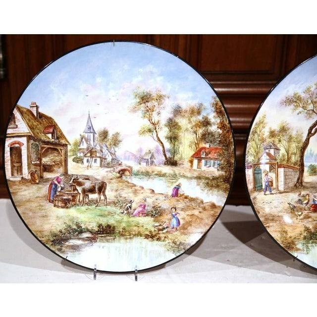 Country Early 20th Century French Hand-Painted Faience Wall Plates - A Pair For Sale - Image 3 of 10