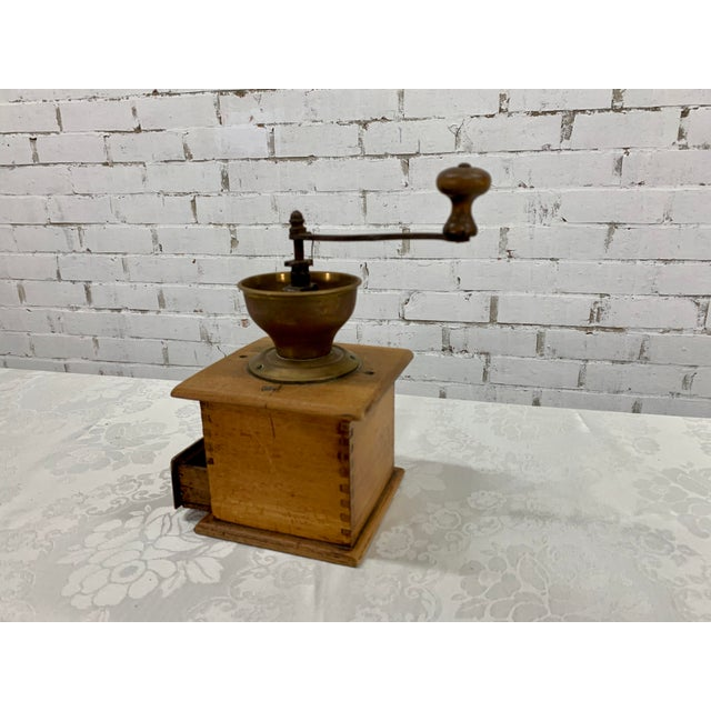 Vintage Italian wood & metal coffee grinder. Coffee lovers delight! Usable antique Coffee grinder with drawl on the bottom...