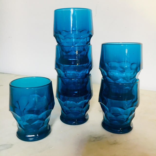 Stunning set of six turquoise glass rock glasses with cubist cut bases. All of these vintage bar glasses are in great...