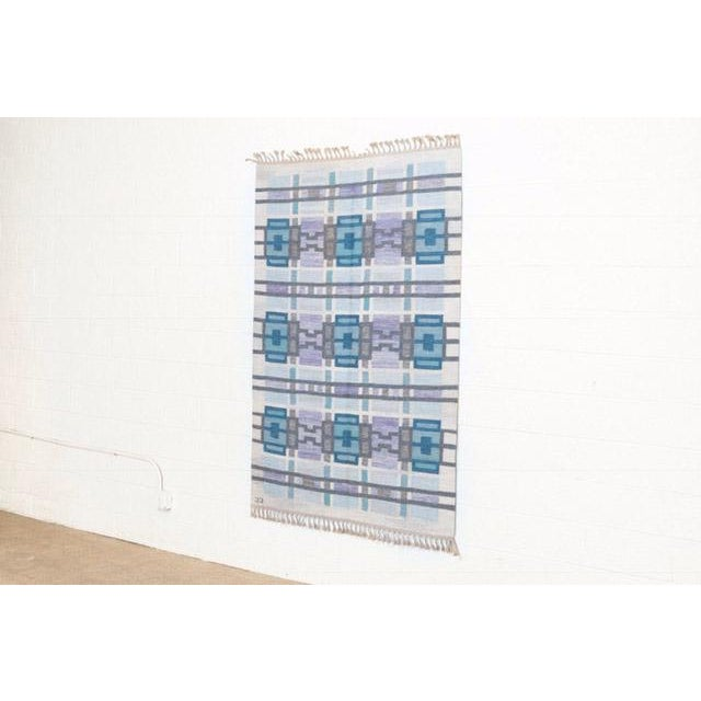 This Scandinavian modern tapestry rug was designed by Judith Johansson (Swedish, 1916-1993) and made in Sweden circa...