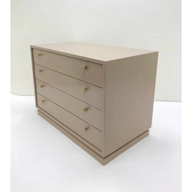 A glamorous lacquered and polished bronze four drawer nightstand design by Steve Chase in the 1980s. Newly lacquered in a...