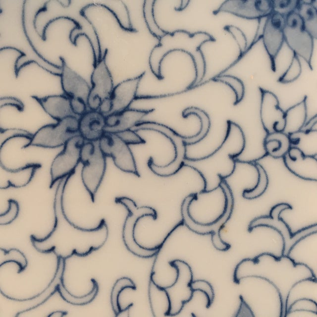 Set of 4 different patterned Oriental design plates in Blue and White. Perfect for serving or holding trinkets.Made in Japan