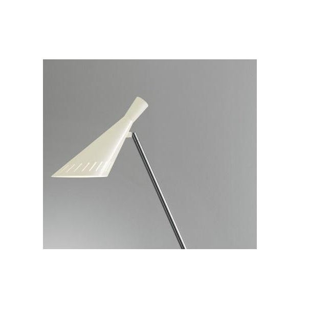 Ivory floor light with an adjustable head. The shade has decorative slots to allow light spill. Warm LED light emits...