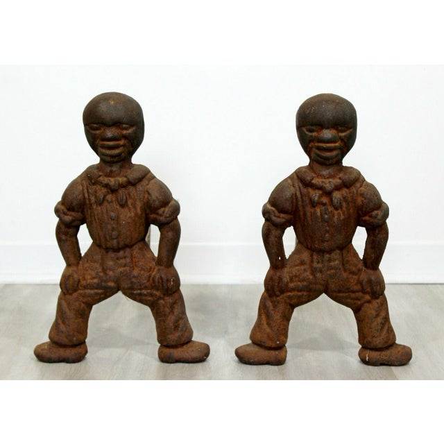 For your consideration is an interesting pair of antique, brutalist, African Art iron andirons, in the shape of figurines....