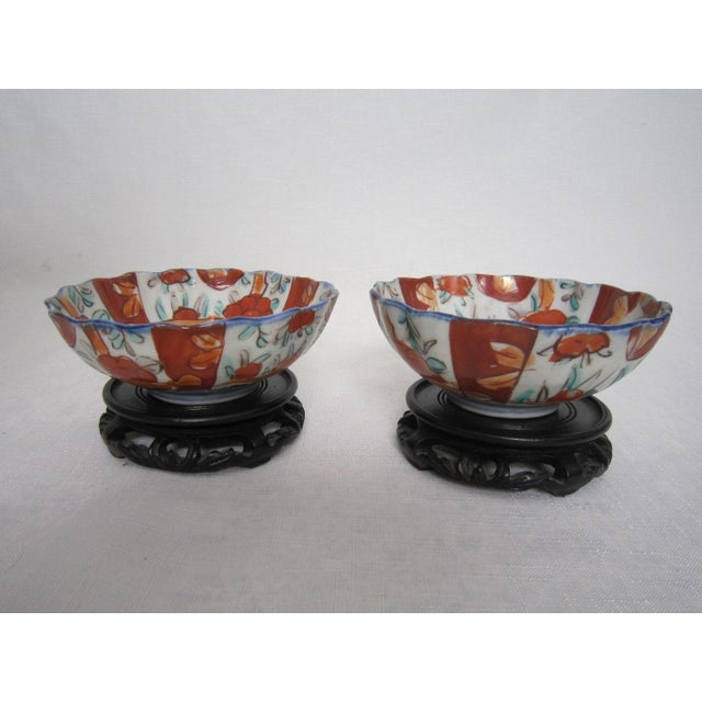 """Offered is a gorgeous pair of old Japanese Kutani bowls with carved rosewood stands. Each bowl measures 2""""H x 5"""" D. The..."""
