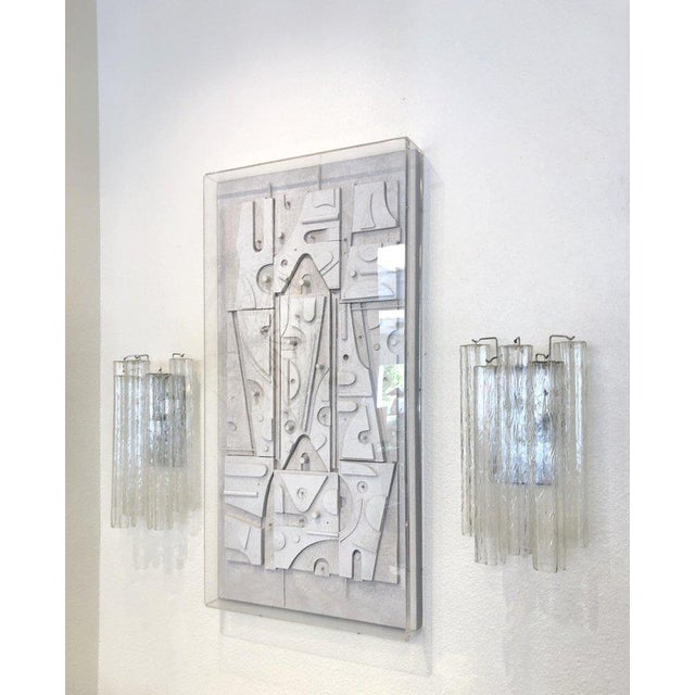"A spectacular pair of large Italian Murano glass ""Tronchi"" Wall Sconces designed by Venini in the 1970s. The Sconces..."