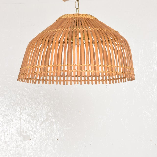 For your consideration, a Mid Century Modern Rattan Pendant Ceiling Hanging Lamp, After Franco Albini. Unmarked. The USA...