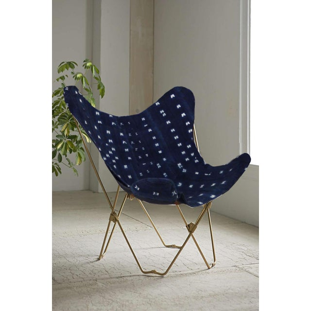 This made in Brooklyn butterfly chair featuring vintage African indigo mudcloth is the perfect combo of Mid-Century modern...