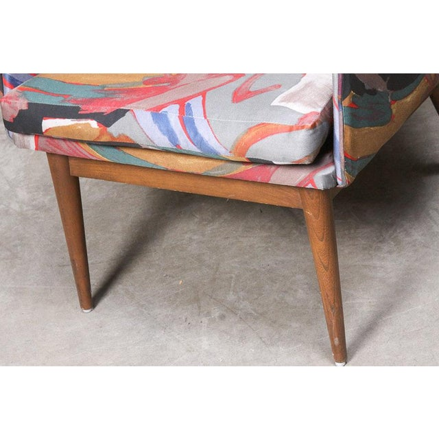 A set of four matching Danish Modern style chairs. The chairs have barrel backs, and are padded and upholstered in...