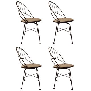Set of Four Wrought Iron Swivel Chairs For Sale