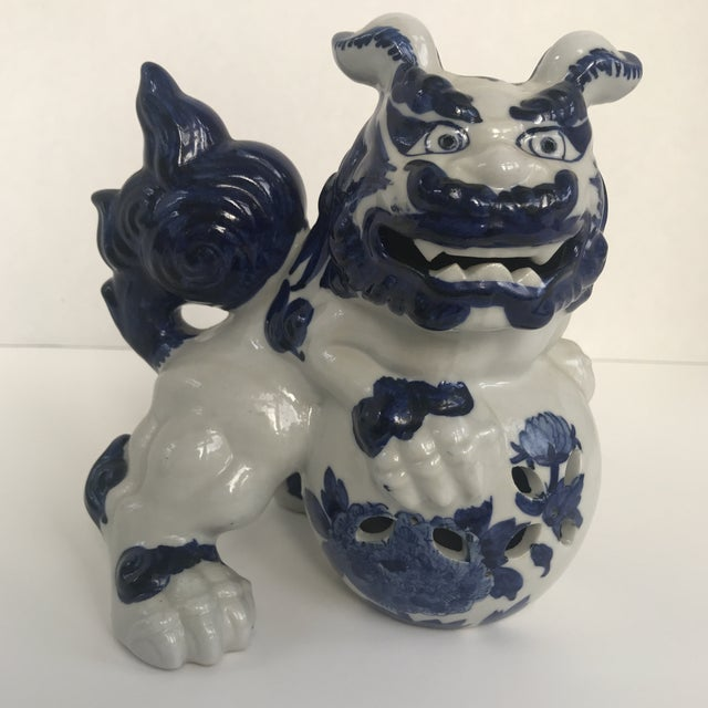 Vintage( or possibly newer) blue and white food dog. Handprinted and a great design. Chinese marking on verso