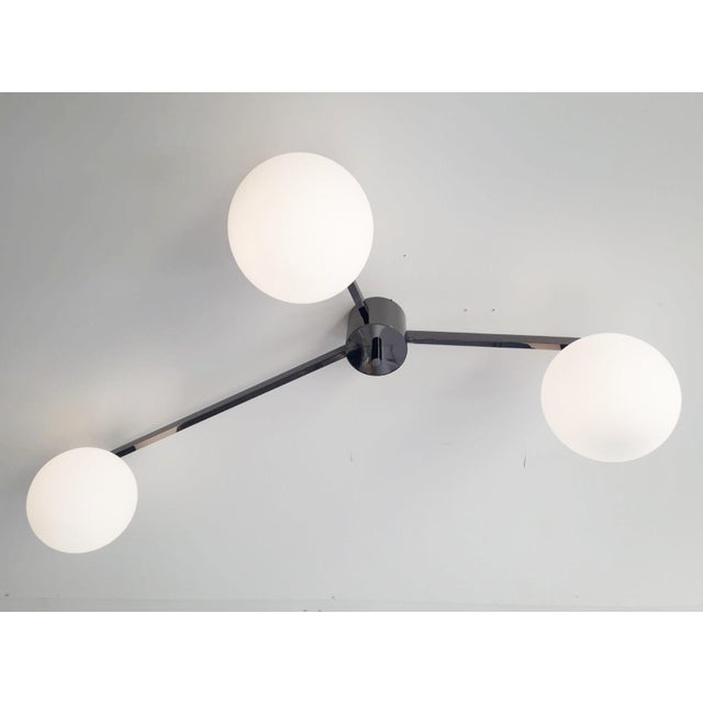 Italian flush mount with matte white Murano glass globes, mounted on polished black nickel finish frame / Designed by...