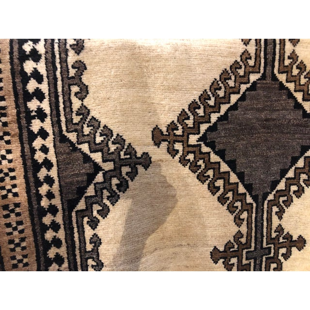 """Vintage Persian Gabbeh rug featuring a bold geometric pattern in neutral colors. Wool. Circa 1970. 4'4"""" x 7'4"""""""