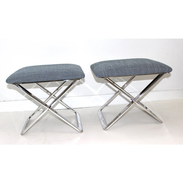 Super-chic pair of Mid-Century Modern X-Stools in polished stainless steel attributed to Milo Baughman. Newly re-upholstered