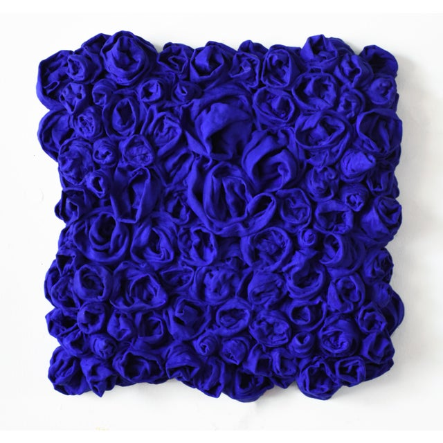 """""""Ultra Blue Rosettes"""" is a mixed media wall sculpture made with cotton and paint on a wooden box. The elegant folds are..."""