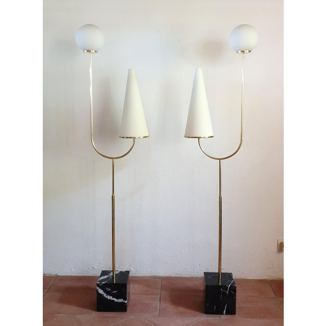 Pair of large Italian Mid-Century Modern floor lamps, circa 1960s Made of a black marble, with white veins square base: 8...