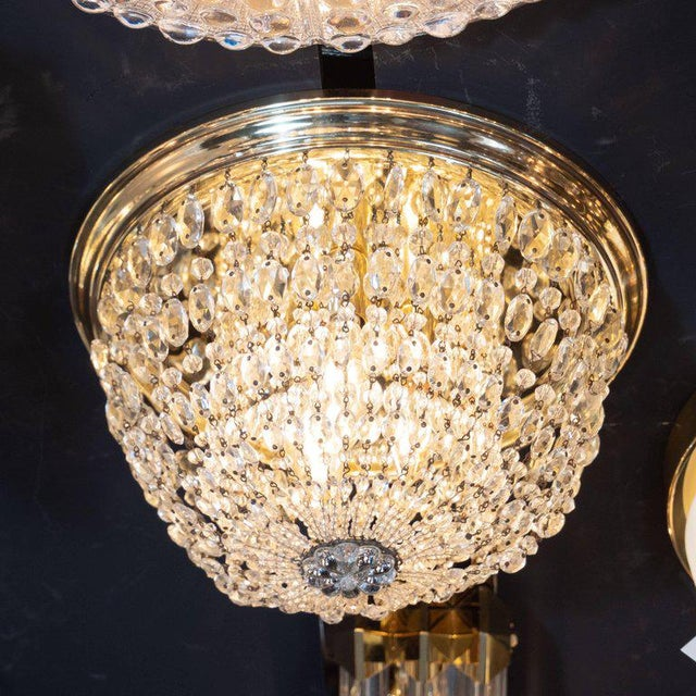 This glamorous and elegant Hollywood flush mount was realized in the United States, circa 1945. It features a stepped...
