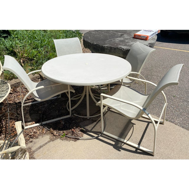 For your consideration is a phenomenal outdoor patio set of four Margaraita patio chairs and matching dining table, by...