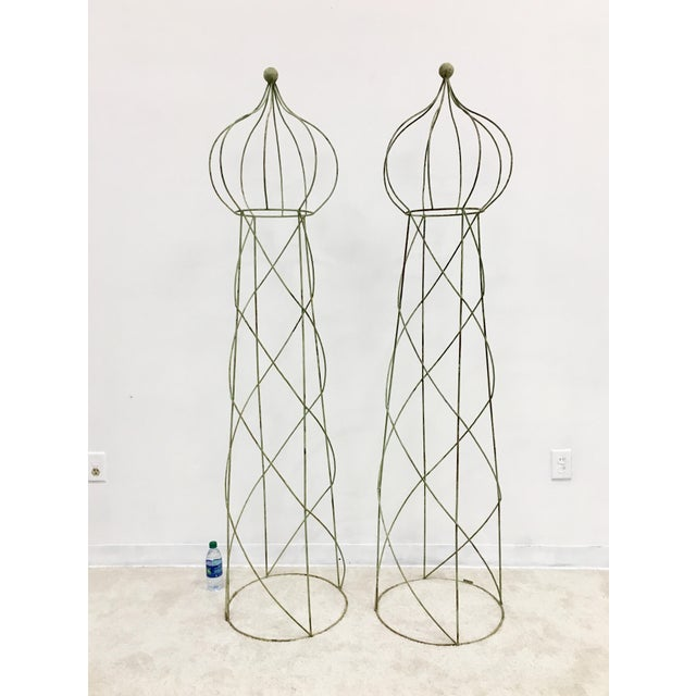 Towering Topiary trellis with distressed sage green paint. Would be beautiful by themselves on each side of an entry, or...