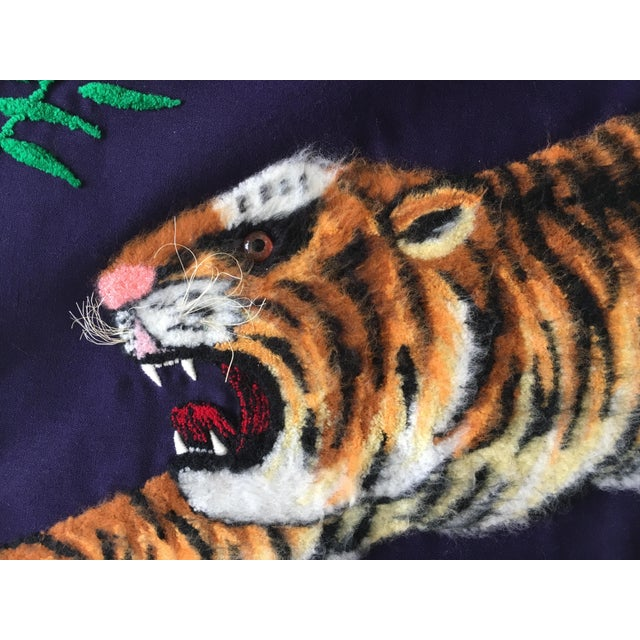 A beautiful tapestry of a Bengal tiger on a deep purple background. The yarn used on the body is slightly longer making it...