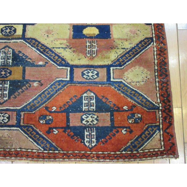 This is a vintage hand knotted Turkish Anatolian rug. it is made with wool dyed in primary colors in a simple geometric...