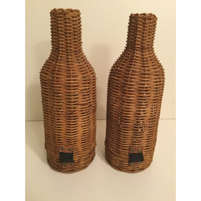 It's wine o'clock somewhere. This pair of vintage wicker bottle holders open & snap closed from the bottom with leather...