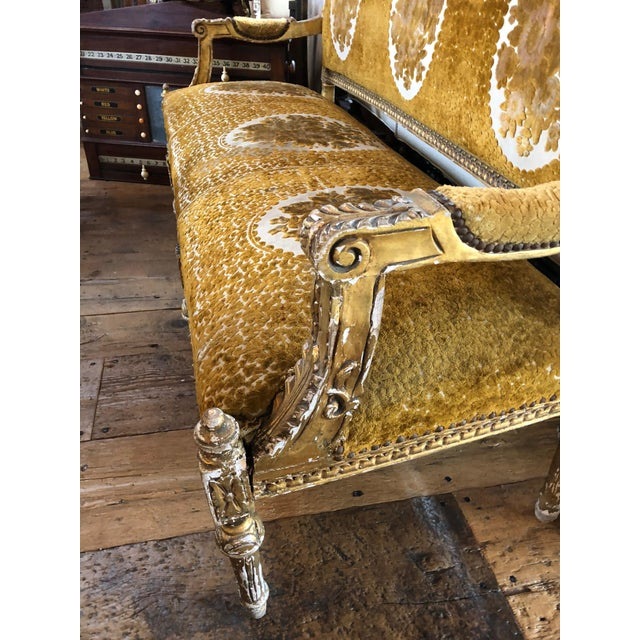 Stunning 19th century French neoclassical style figural gold gilt painted settee covered in original gold and cream cut...