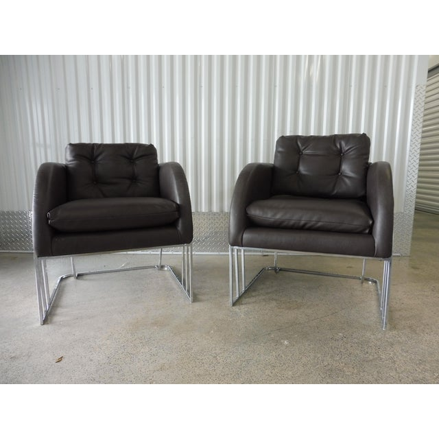Superb pair of 1970's directional Milo Baughman chrome and leather club chairs sold as found in vintage condition showing...