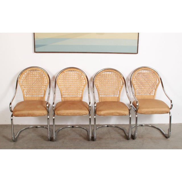 Fabulous set of 4 vintage mid century modern Italian chrome & woven rattan / wicker cantilevered dining chairs! These...