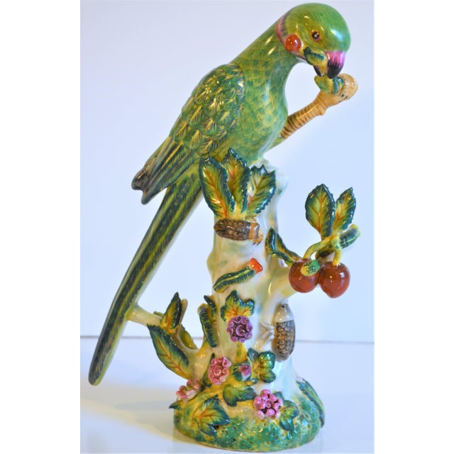 This is a beautiful green and chartreuse majolica parrot in a Chinese Import style detail. It has beautiful green teal...