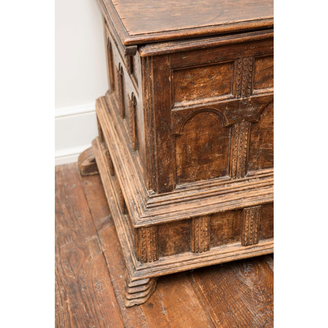 Crafted walnut chest, artistically detailed woodwork. This piece would look great in a living area or family room.