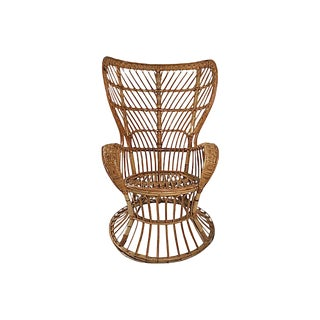 Rattan Wingback Chair by Lio Carminati For Sale