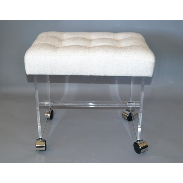 Mid-Century Modern Lucite stool with newly upholstered tufted boucle fabric seat on chrome casters. This stool can be used...
