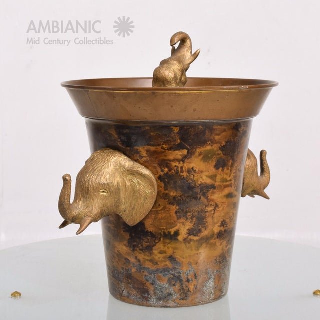 For your consideration a vintage ice bucket made of brass. Beautiful and unique. The bucket is made of brass and has a...