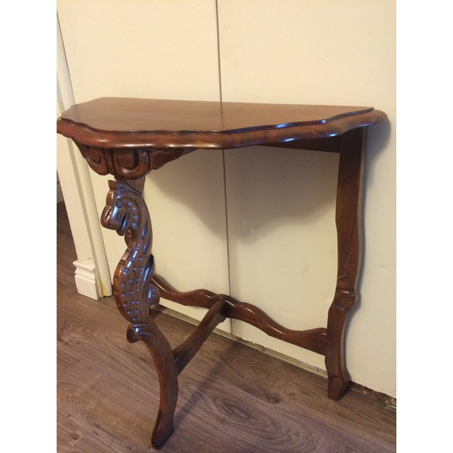 Accent your interior with a hand-carved antique side table. A fictitious animal head has been carved onto the front leg...